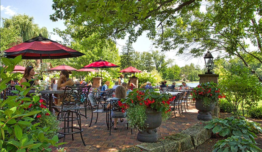 The Piazza entails relaxed outdoor patio dining with views of the picturesque spring-fed lake at Gervasi Vineyard